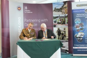 Kevin Mulholland and Major General Mark Gaunt signing the Armed Forces Covenant