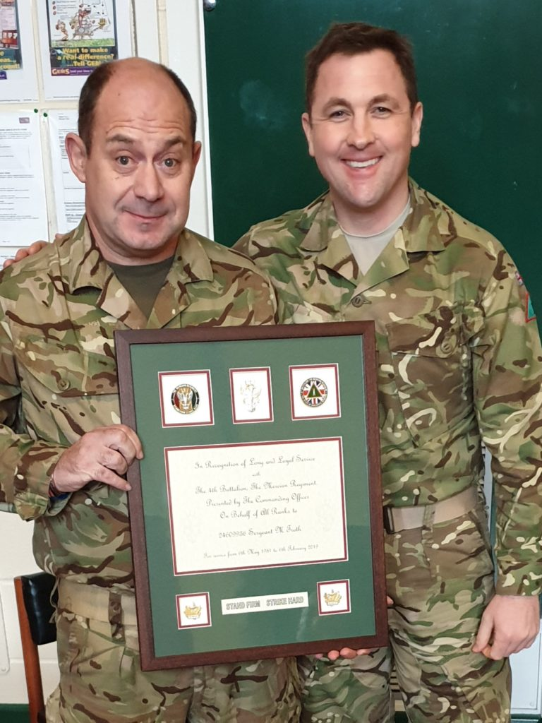 Sergeant Troth receives framed memento for his 38 years of service to the Army Reserve