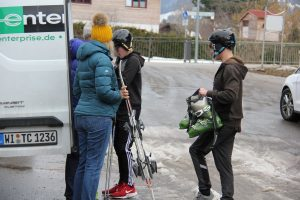 Cadets loading ski equipment in to van