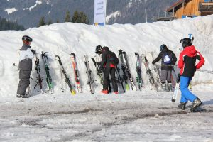Ski's lined up along a snowy mound, ready for the day ahead.