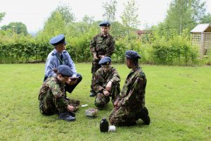 Cadets demonstrating fieldcraft skills