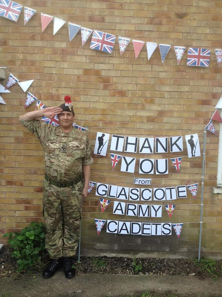 Adult Volunteer salutes for VE Day