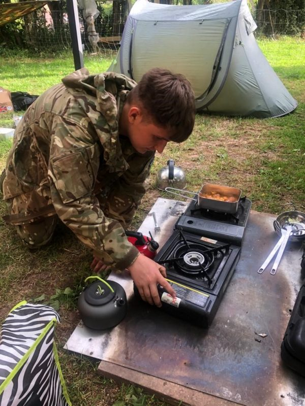 Hereford and Worcester Army Cadet Force cadet gets to grips with cooking his own ration pack