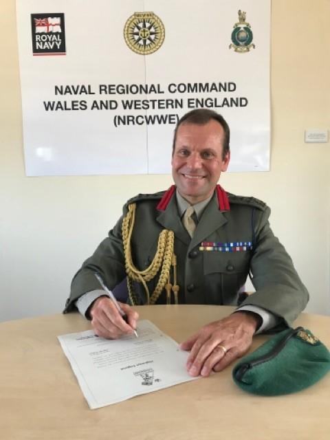 Brigadier Graeme Fraser Royal Marines, signs the Armed Forces Covenant on behalf of the Ministry of Defence