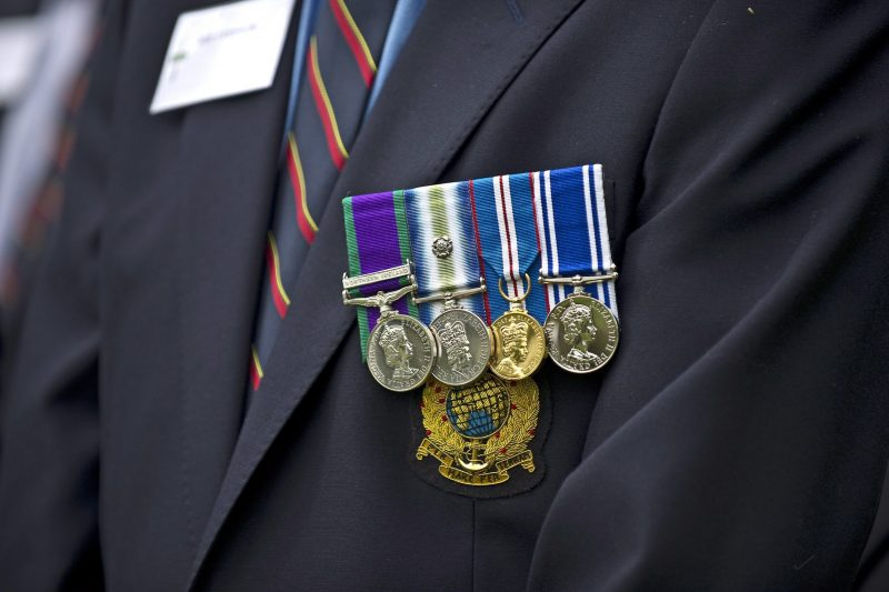 A veteran wearing his medals with pride
