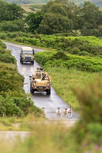 Jackal 2 vehicle and Land Rover on training camp