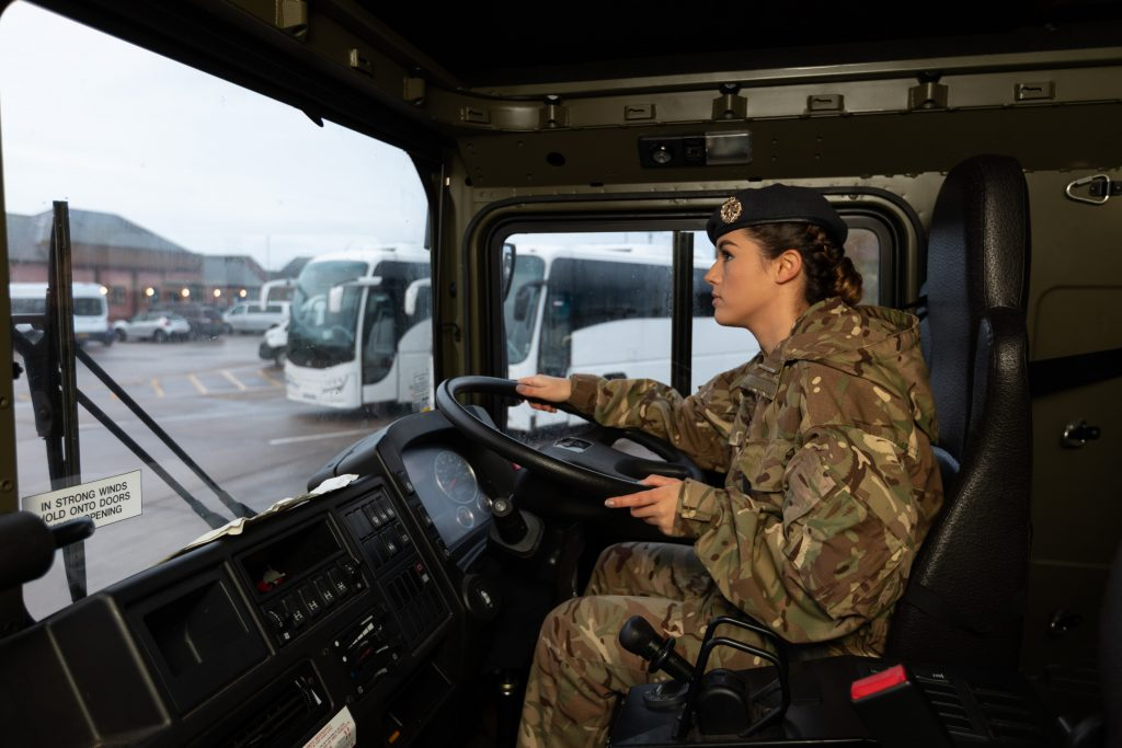Senior Aircraftman (SAC) Caitlin Boudewyn, a Royal Air Force Reservist, driving in the MT section at Lossiemouth.