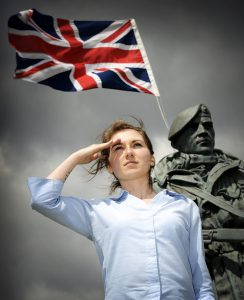 Saluting our Forces with statue and union flag