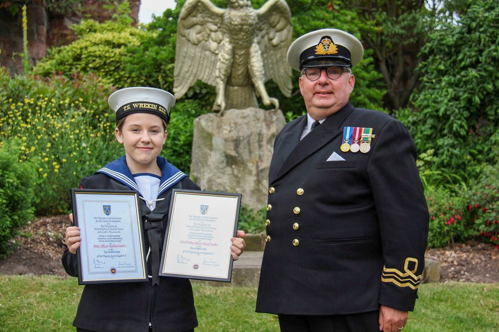 The outgoing Shropshire Lord-Lieutenant Sea Cadet and volunteer proudly hold their certificates