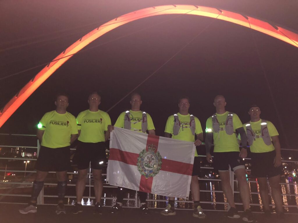 The 'Running Fusliers' pose for the camera on the Millenium Bridge in Newcastle